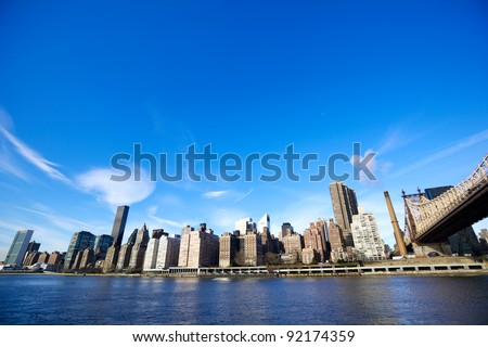 Midtown Manhattan with New York City skyline and Queensboro Bridge over East River - stock photo