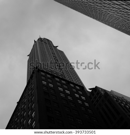 Midtown NYC - March 16 2016 - Looking up at the Chrysler building, an art deco gem in midtown.   - stock photo