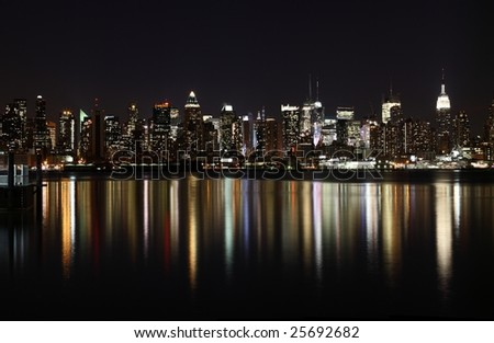 Midtown (West Side) Manhattan at night (panoramic photo made of multiple shots -> great resolution, very suitable for large size prints) - stock photo