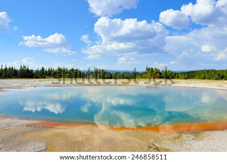 Midway Geyser Basin and reflection of clouds in Yellowstone National Park, Wyoming - stock photo