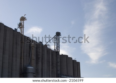 Midwest corn and grain elevator against the sky - stock photo
