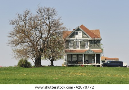 Midwest Farmhouse and Bare Tree - stock photo