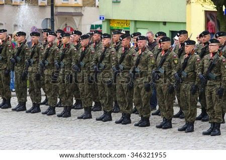 MIEROSZOW, POLAND - November 11, 2015: Group of polish soldiers during Independence Day event in little town Mieroszow. This event occurs each year in many towns in Poland after independence in 1918 - stock photo
