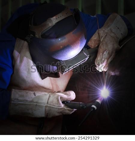 MIG welder welding big column with mig method - stock photo