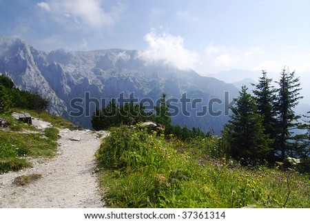 Mighty Alpine mountain range in Austria, spring time and path