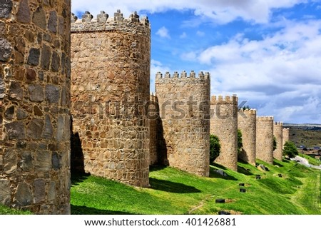 Mighty medieval wall and towers surrounding the old town of Avila, Spain - stock photo