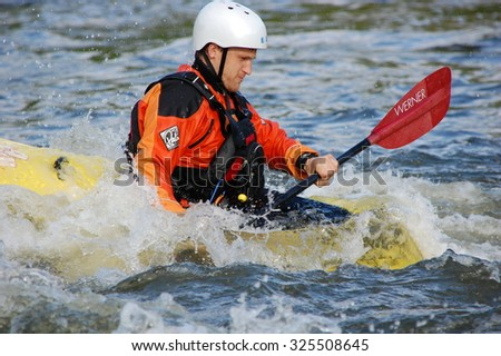 MIGIYA, UKRAINE - APRIL 30: Athlete from kayakers club train in rapid, called Integral on April 30, 2014 on the Southern Bug River, Ukraine. - stock photo