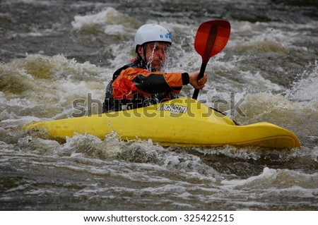 MIGIYA, UKRAINE - MAY 1: Kayaker doing the eskimo roll. Athletes from kayakers club train in the river threshold called Integral on May 1, 2014 on the Southern Bug River, Ukraine. - stock photo
