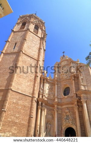 Miguelete belfry above the facade of the Metropolitan Cathedral - Basilica of the Assumption of Our Lady of Valencia (known as Saint Mary's Cathedral or Valencia Cathedral), Valencia, Spain - stock photo