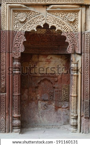 Mihrab, architectural element of mosque, showing direction to Mecca, in Qutub Minar complex in Delhi.Qutb, the tallest minar in India,ancient Islamic Monument,UNESCO World Heritage  - stock photo