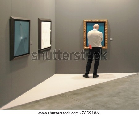 MILAN - APRIL 08: A man visits sculpture, painting and art galleries during MiArt ArtNow, international exhibition of modern and contemporary art on April 08, 2011 in Milan, Italy. - stock photo