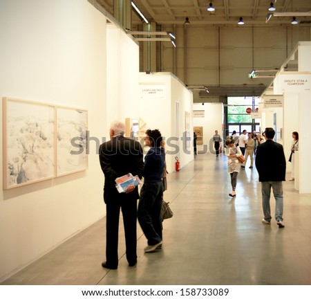 MILAN - APRIL 08: Couple look at paintings galleries during MiArt, international exhibition of modern and contemporary art on April 08, 2011 in Milan, Italy  - stock photo