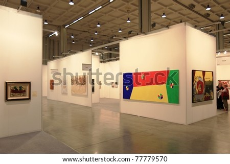 MILAN - APRIL 08: Looking at paintings and sculpture galleries during MiArt, international exhibition of modern and contemporary art on April 08, 2011 in Milan, Italy. - stock photo