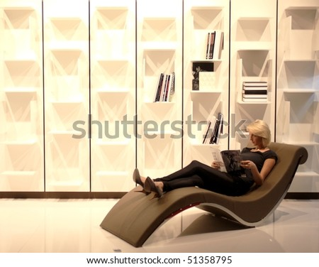 MILAN - APRIL 15: Model posing on luxury interior background during Salone del Mobile, international furnishing accessories exhibition April 15, 2010 in Milan, Italy. - stock photo