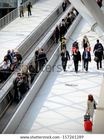 MILAN - APRIL 15: Panoramic view of people walking to the entrance of Salone del Mobile, international furnishing accessories exhibition April 15, 2010 in Milan, Italy.  - stock photo