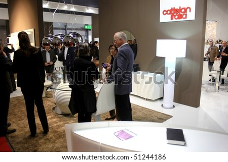 MILAN - APRIL 15: People at Cattelan interiors stand during Salone del Mobile, international furnishing accessories exhibition April 15, 2010 in Milan, Italy.