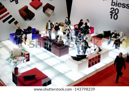 MILAN - APRIL 15: People at design exhibition stands during Salone del Mobile, international furnishing accessories exhibition April 15, 2010 in Milan, Italy. - stock photo