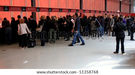 MILAN - APRIL 15: People enter Salone del Mobile, international furnishing accessories exhibition April 15, 2010 in Milan, Italy.