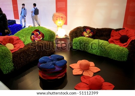 MILAN - APRIL 15: People look at colored interior design in exhibition during Salone del Mobile, international furnishing accessories exhibition April 15, 2010 in Milan, Italy. - stock photo