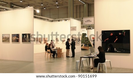 MILAN - APRIL 08: People look at paintings and sculpture galleries during MiArt, international exhibition of modern and contemporary art on April 08, 2011 in Milan, Italy.