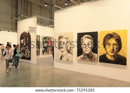 MILAN - APRIL 08: People look at paintings dedicated to Marilyn Monroe, Paul Newman and John Lennon at MiArt, international exhibition of modern and contemporary art on  April 08, 2011 in Milan, Italytthanks - stock photo