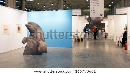 MILAN - APRIL 07: People look at sculpture and paintings galleries at MiArt, international exhibition of modern and contemporary art April 07, 2013 in Milan, Italy. - stock photo