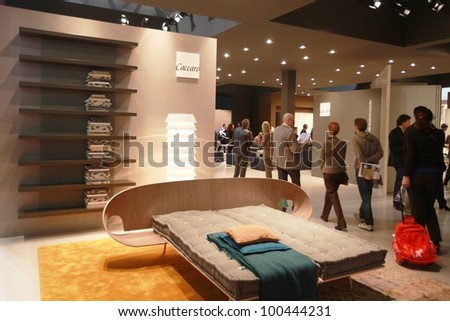 MILAN - APRIL 17: People visit architecture and interiors design pavillions at Salone del Mobile, international furnishing accessories exhibition on April 17, 2012 in Milan, Italy.