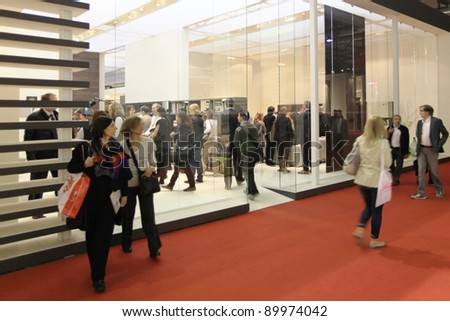 MILAN - APRIL 13: People visit interior design pavilions at Salone del Mobile, international furnishing accessories exhibition on April 13, 2011 in Milan, Italy.