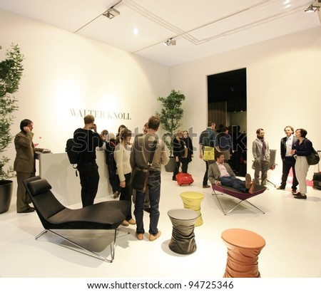 MILAN - APRIL 13: People visit Salone del Mobile, international furnishing accessories exhibition on April 13, 2011 in Milan, Italy.