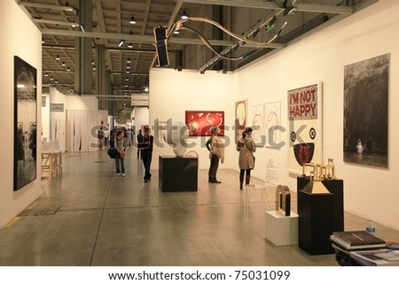 MILAN - APRIL 08: People visit sculpture, painting and art galleries during MiArt ArtNow, international exhibition of modern and contemporary art April 08, 2011 in Milan, Italy. - stock photo