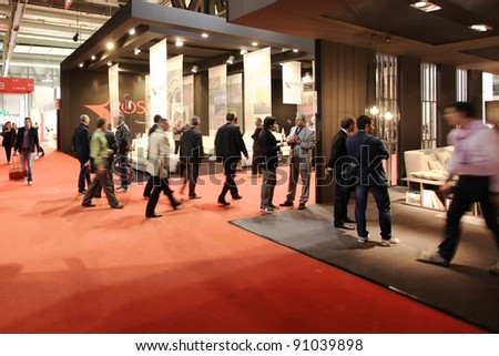 MILAN - APRIL 13: Visitors look at interiors design stands and home architecture solutions during Salone del Mobile, international furnishing accessories exhibition on April 13, 2011 in Milan, Italy. - stock photo