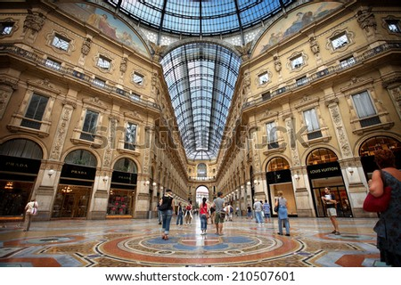 MILAN - AUGUST 6, 2006: Shoppers browse high fashion stores in Milan's elegant Galleria Vittorio Emanuele II on August 6, 2006. - stock photo