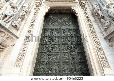 Milan cathedral door detail - brass bas relief art. Architecture in Italy.