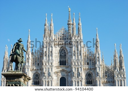 Milan Cathedral (Duomo di Milano) and Vittorio Emanuele II statue - stock photo