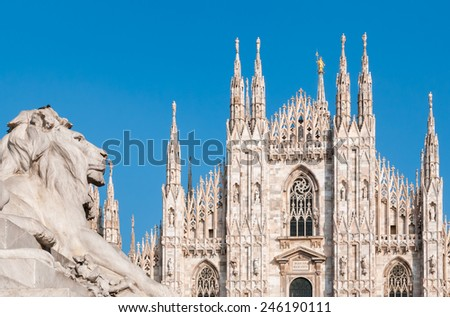 Milan Cathedral with monument of lion, Italy - stock photo