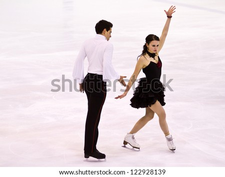 MILAN -DEC 22:  Anna Cappellini and Luca Lanotte perform in the Senior Dance category during Italian Championship  on Dec 22, 2012 in Milan, italy. They win a gold medal