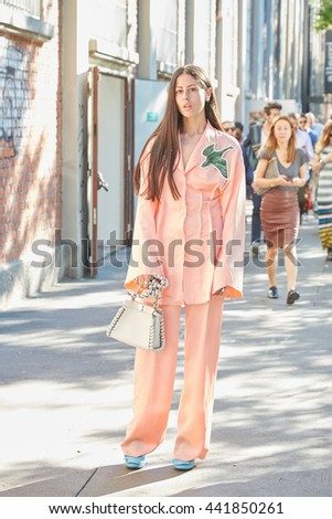 MILAN - FEBRUARY 20: Gilda Ambrosio poses for photographers with pink suit before Fendi fashion show, Milan Men's Fashion Week street style on June 20 2016 in Milan. - stock photo