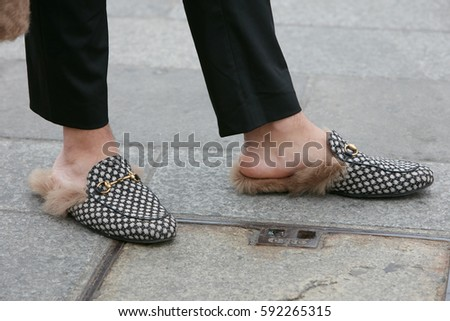 gucci shoes black and white. milan - february 22: man with gucci shoes fur and black trousers before cristiano white