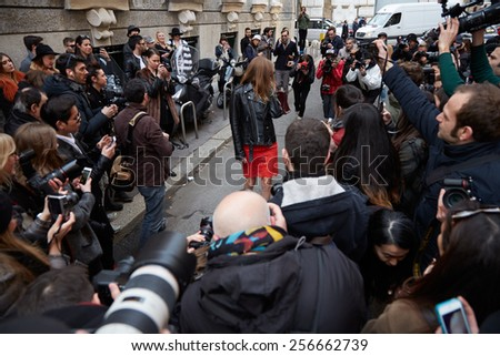 MILAN - FEBRUARY 25: Photographers shooting street style look before Alberta Ferretti show Milan Fashion Week Day 1, Fall/Winter 2015/2016 street style day 1, on February 25, 2015 in Milan.