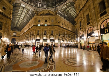 MILAN - FEBRUARY 5: Vittorio Emanuele II shopping gallery on February 5, 2012 in Milan, Italy. Inaugurated in 1865, the gallery claims to be the oldest shopping center worldwide. - stock photo