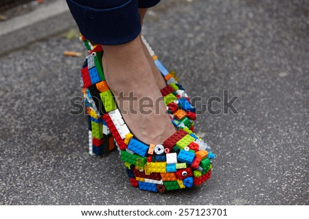 MILAN - FEBRUARY 26: Woman poses for photographers before Just Cavalli show in lego shoes Milan Fashion Week Day 2, Fall/Winter 2015/2016 street style on February 26, 2015 in Milan. - stock photo