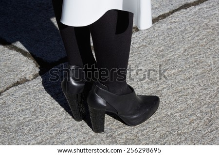 MILAN - FEBRUARY 25: Woman poses for photographers in black shoes before Stella Jean show Milan Fashion Week Day 1, Fall/Winter 2015/2016 street style day 1, on February 25, 2015 in Milan.