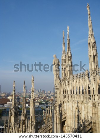 Milan gothic cathedral at the piazza del duomo - stock photo