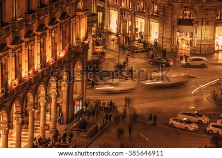 Milan, Italy: aerial view of Cathedral square, Piazza del Duomo in sunset - stock photo