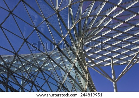 MILAN, ITALY - APR 9: Architectural detail of the Milan Trade fair  on April 9 2014, with its modern architectural roof made of glass and steel. - stock photo