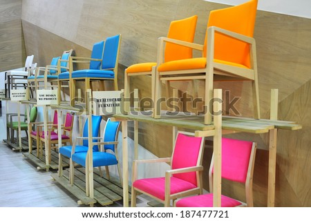 MILAN, ITALY - APR 9: Colorful chairs  at Salone del Mobile, international furnishing accessories exhibition in Milan, Italy- April 9, 2014   - stock photo