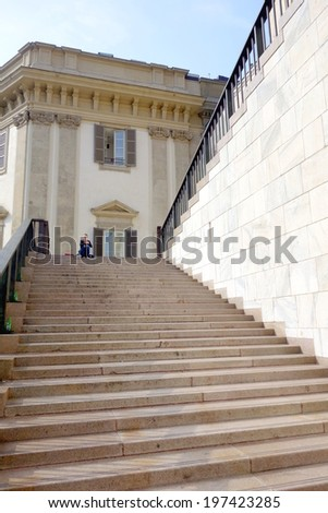 MILAN, ITALY - APRIL 12, 2014: A wide stairway of the Arengario building in Milan, Italy. The Arengario was completed in the 1950s and currently houses the Museo del Novecento