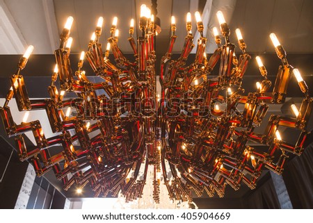 MILAN, ITALY - APRIL 13: Beautiful chandelier on display at Fuorisalone, set of events distributed in different areas of the town during Milan Design Week on APRIL 13, 2016 in Milan. - stock photo