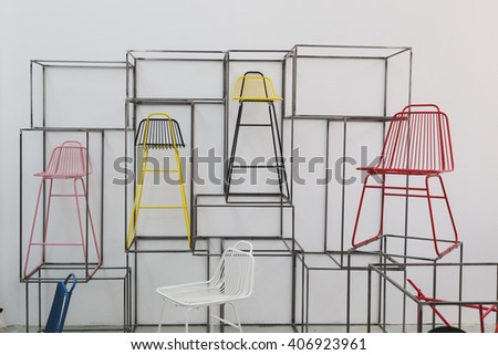 MILAN, ITALY - APRIL 16: Chairs on display at Fuorisalone, set of events distributed in different areas of the town during Milan Design Week on APRIL 16, 2016 in Milan. - stock photo