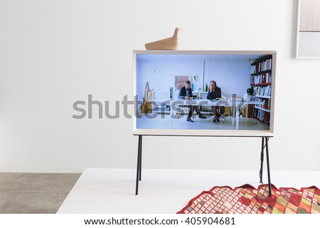 MILAN, ITALY - APRIL 13: Elegant led tv on display at Fuorisalone, set of events distributed in different areas of the town during Milan Design Week on APRIL 13, 2016 in Milan. - stock photo